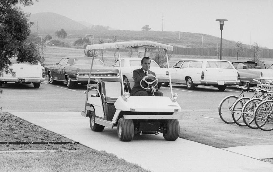 Richard Nixon Driving A Golf Cart Photograph