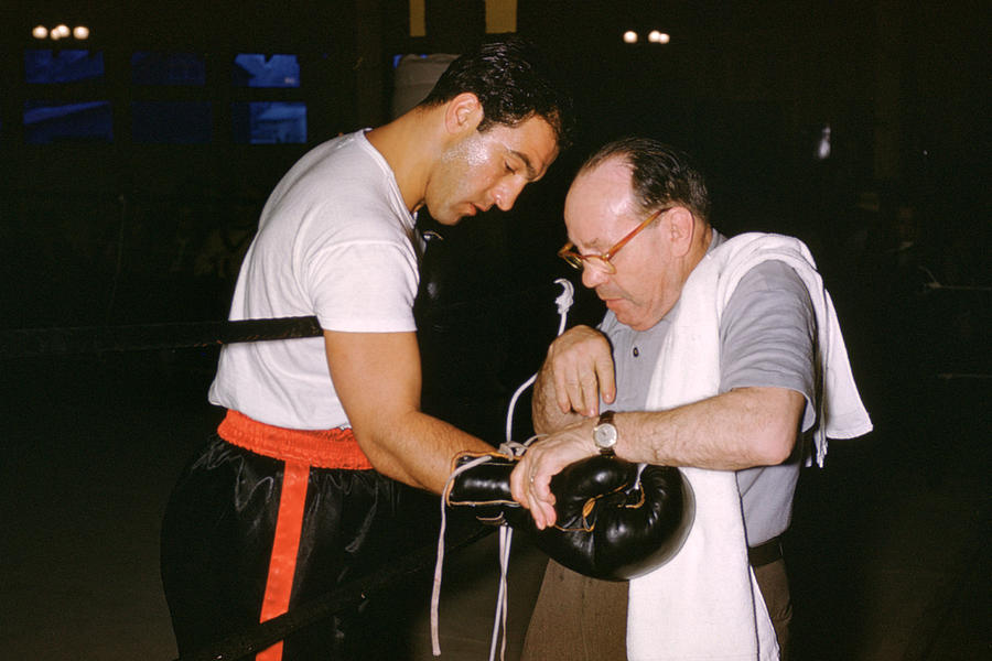 Rocky Marciano Looking At Glove Photograph