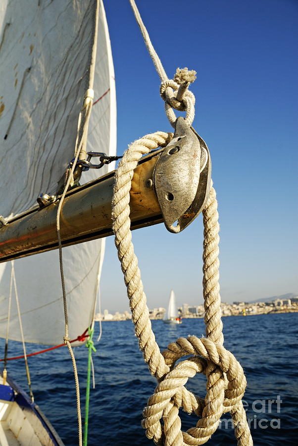 Rope On Sailboat Mast During Navigation Photograph