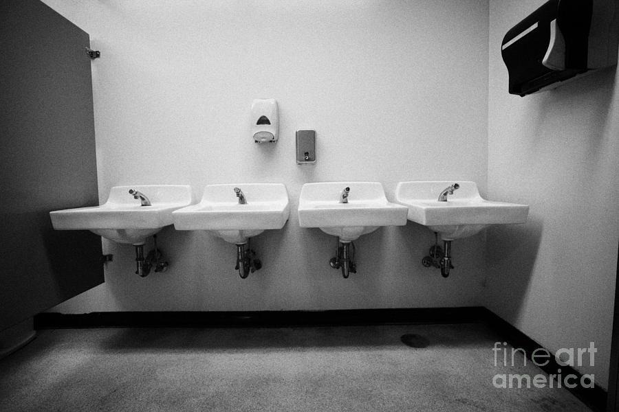 row of sinks in female washroom High school canada north america by ...