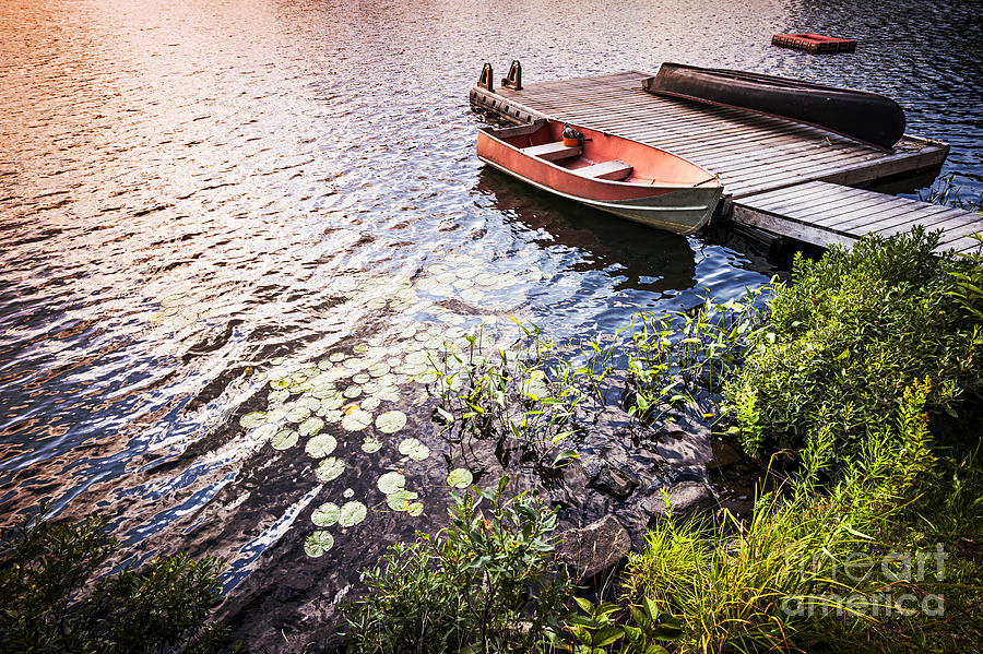 Rowboat At Lake Shore At Sunrise Photograph