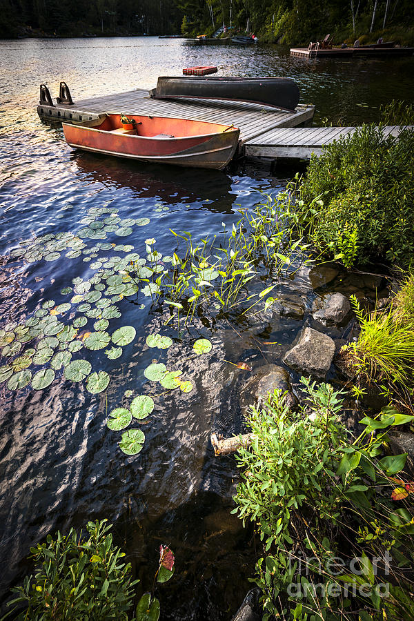 Rowboat At Lake Shore Photograph