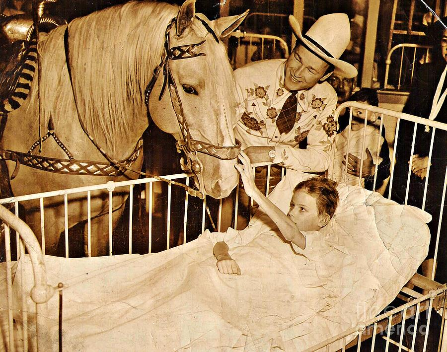 Roy Rogers And Trigger With A Polio Victim In Pittsburgh Photograph - Roy Rogers And Trigger With A Polio Victim In Pittsburgh by Unknown