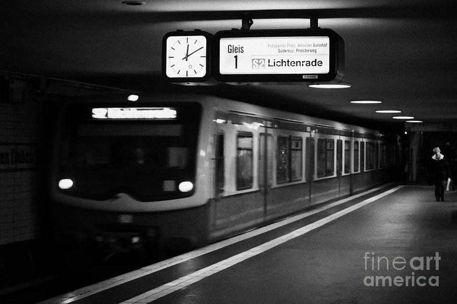 s-bahn train speeding through unter den linden underground station Berlin Germany Photograph  - s-bahn train speeding through unter den linden underground station Berlin Germany Fine Art Print