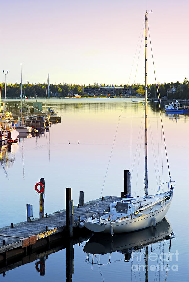 Sailboat At Sunrise Photograph