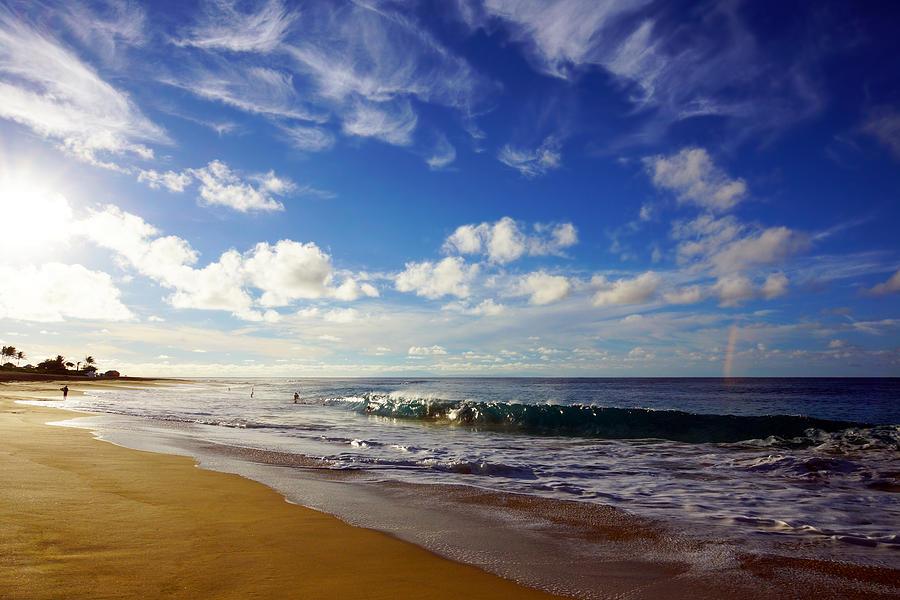 Sandy Beach Morning Rainbow Photograph