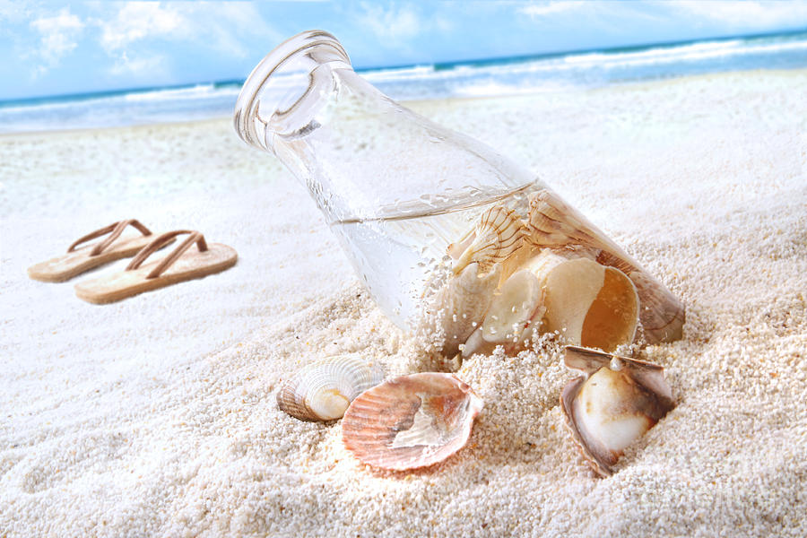 Seashells In A Bottle On The Beach Photograph