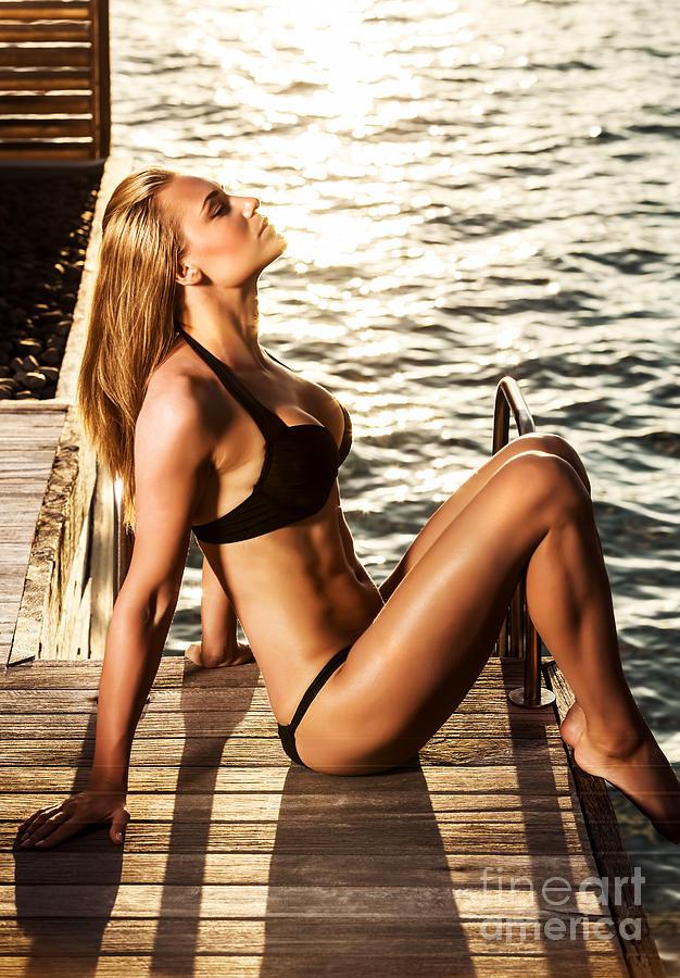 http://images.fineartamerica.com/images-medium-large-5/sexy-girl-sunbathing-anna-omelchenko.jpg