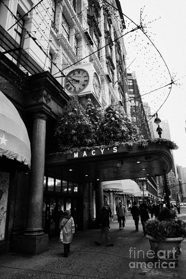 shoppers walk past entrance to Macys department store on Broadway and 34th street at Herald square Photograph