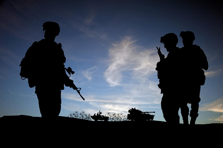 Silhouette Of Modern Soldiers  Photograph