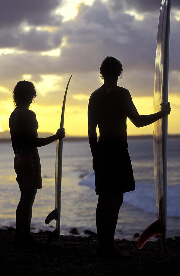 Silhouetted Surfers At Noosa Heads Photograph