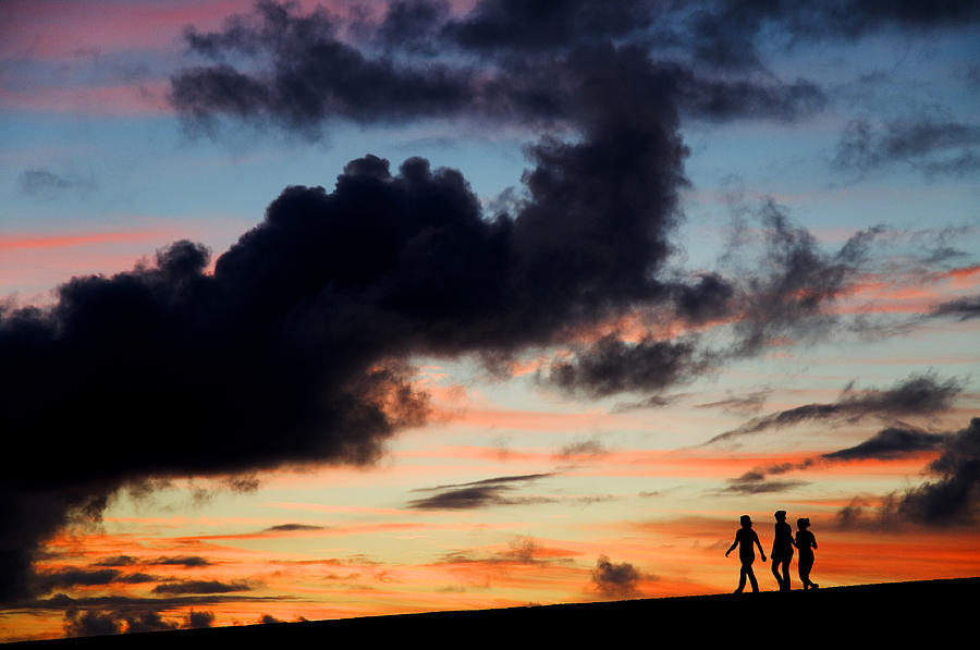 Silhouettes Of Three Girls Walking In The Sunset Photograph