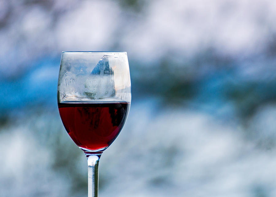 Single Glass Of Red Wine On Blue And White Background Photograph
