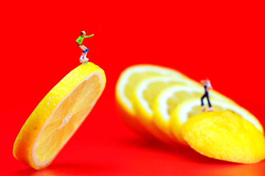 Skateboard Rolling On A Floating Lemon Slice Photograph
