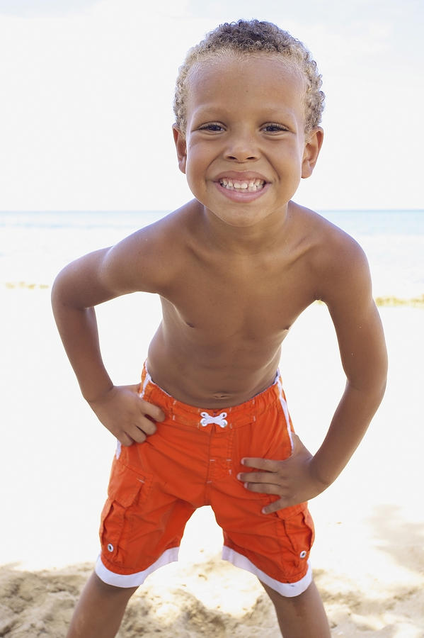 Smiling Boy On Beach Photograph