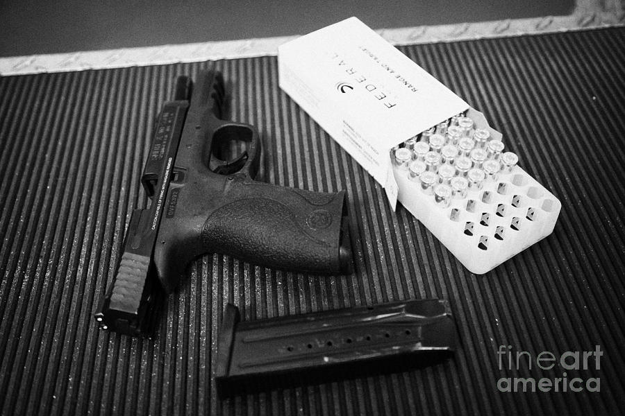 Shooting Photograph - Smith And Wesson 9mm Handgun With Ammunition At A Gun Range by Joe Fox