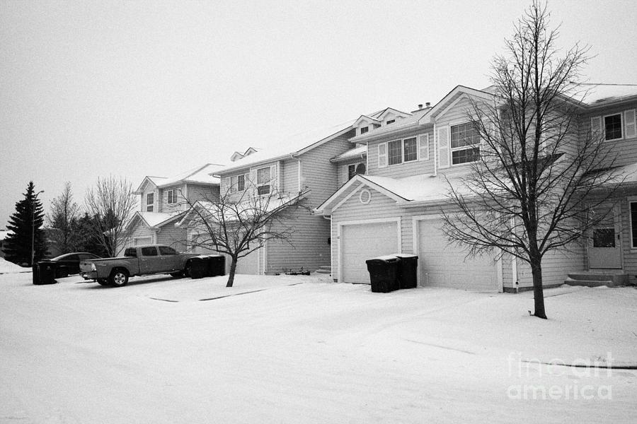 snow falling in residential street during winter Saskatoon Saskatchewan Canada Photograph