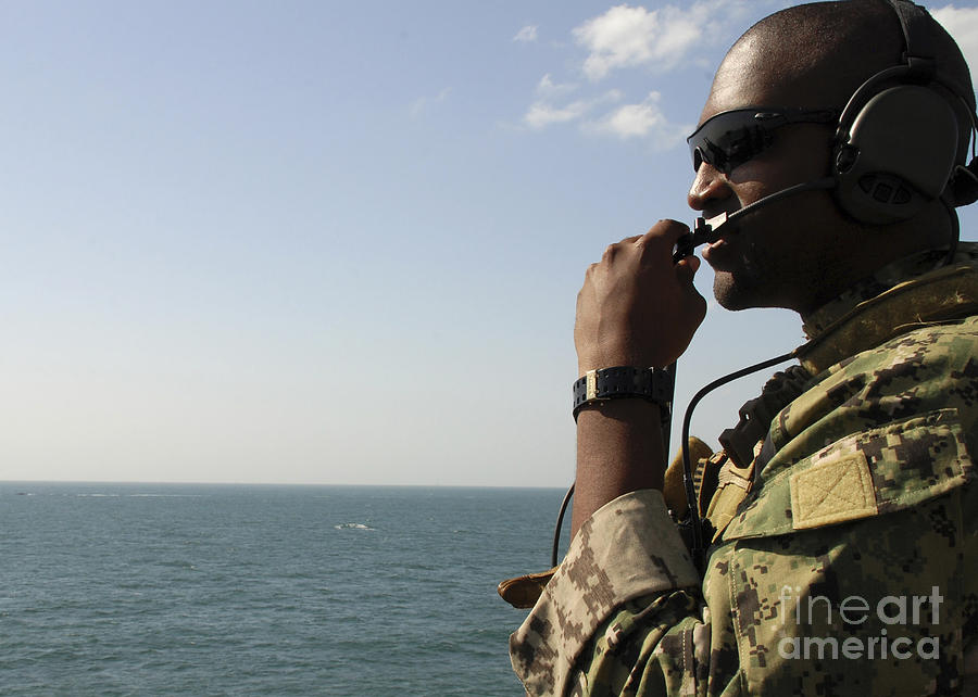 Soldier Instructs Small Boat Maneuvers Photograph