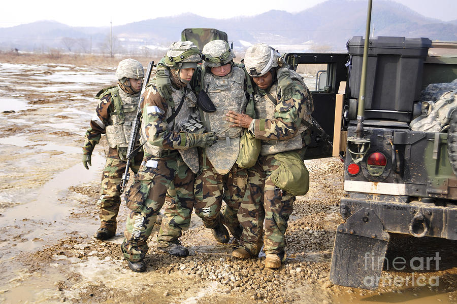 Soldiers Conduct Medical Evacuation Photograph
