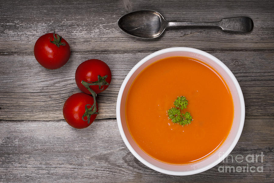 Soup On Wood Table Photograph