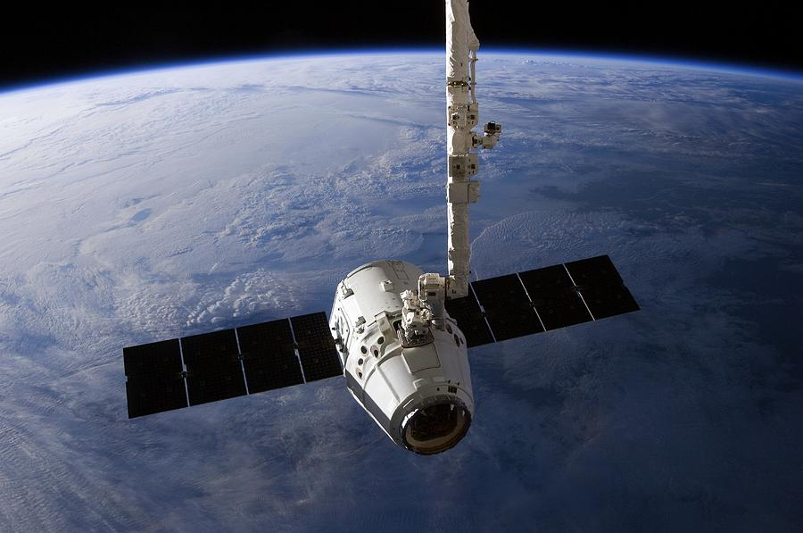 Spacex Dragon Capsule At The Iss Photograph