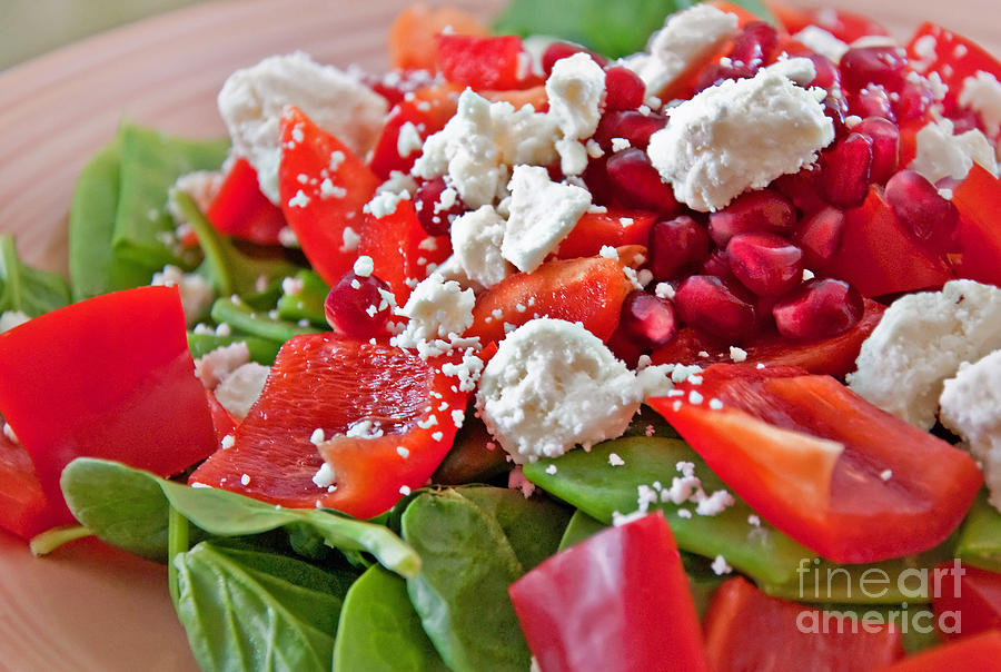 Spinach Salad With Pomegrante Seeds And Feta Cheese Photograph