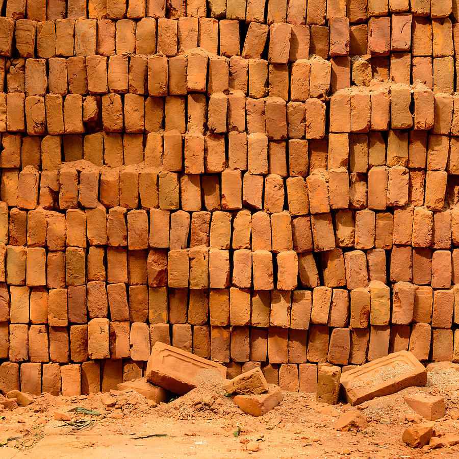 pile of bricks A brick is building material used to make walls  in operation, new green bricks, along with roofing bricks, are stacked at one end of the brick pile.