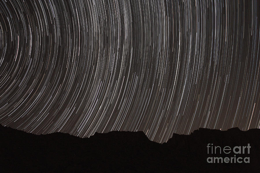 Star Trails Above A Valley Photograph