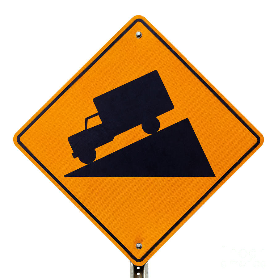 Steep grade hill ahead warning road sign on white photograph