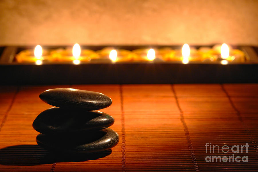 Stone Cairn And Candles For Quiet Meditation Photograph