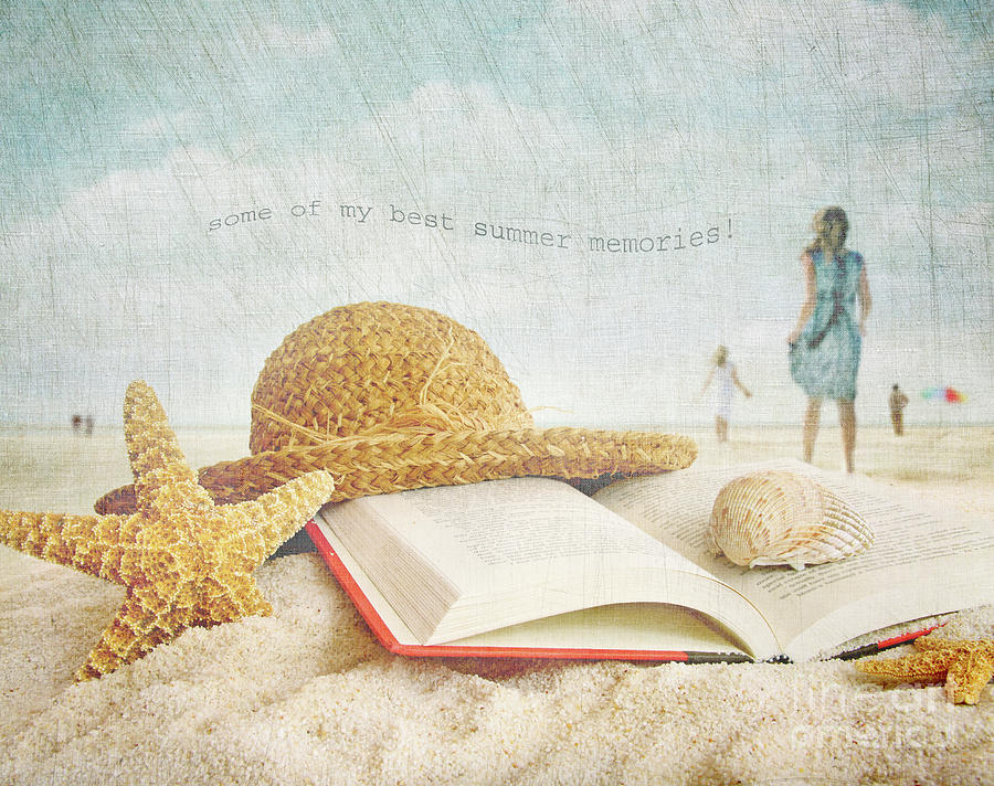 Straw Hat And Book In The Sand Photograph
