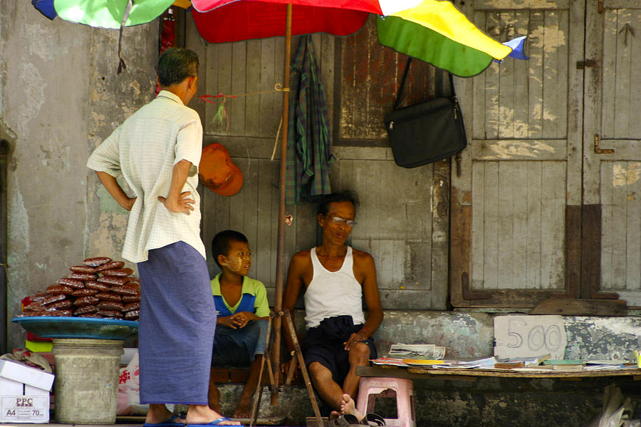 Umbrella Photograph - Street Seller Sitting In The Shade Under An Umbrella Yangon Myanmar by Ralph A  Ledergerber-Photography