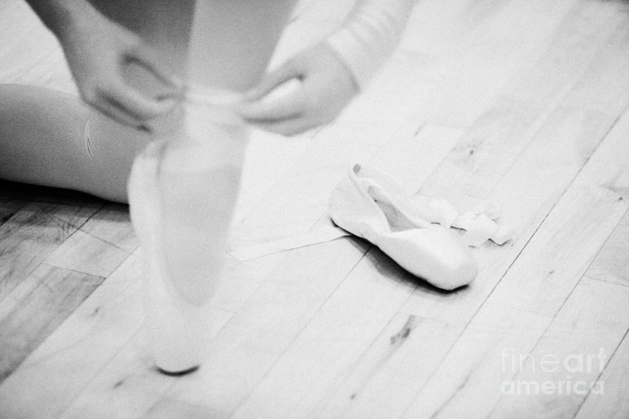 Student Putting On Pointe Shoes At A Ballet School In The Uk Photograph