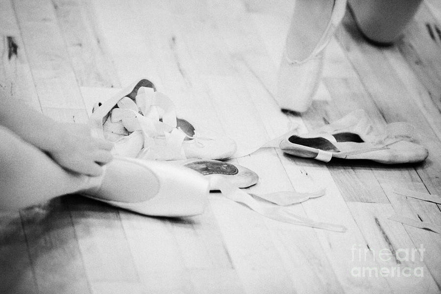 Students Putting On Pointe Shoes At A Ballet School In The Uk Photograph