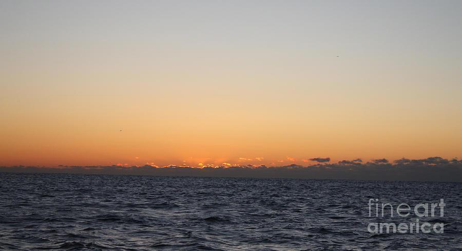 Sun Rising Above Clouds And Horizon Photograph