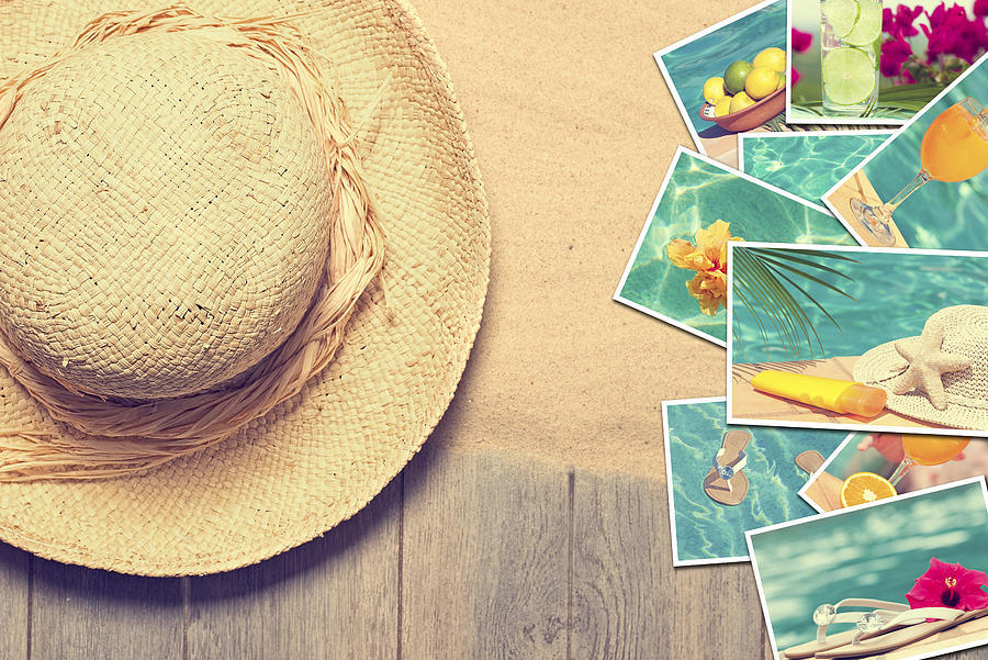 Sunhat And Postcards Photograph