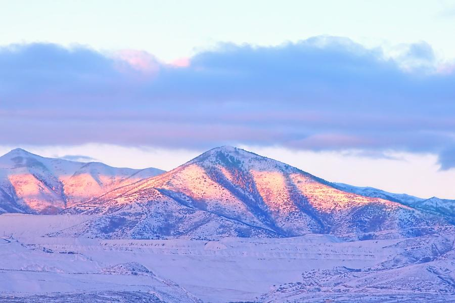 Sunrise On Snow Capped Mountains Photograph