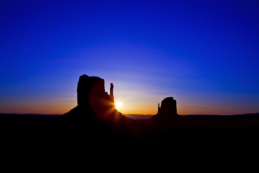 Monument Photograph - Sunrise Over Monument Valley by Susan Schmitz
