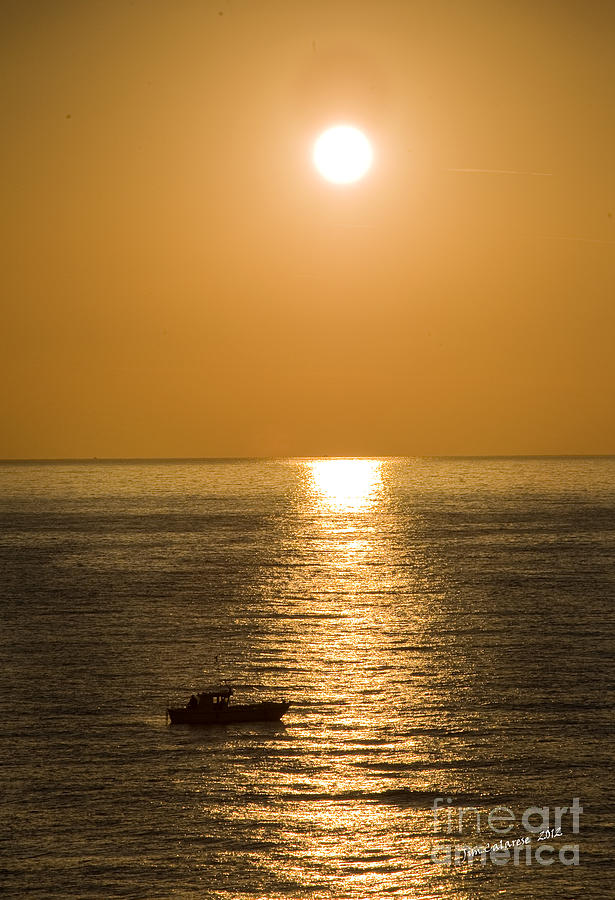 Sunrise Over The Mediterranean With Silhouette Of Boat Crossing The Sun's Resfection In The Water Photograph - Sunrise Over The Mediterranean by Jim  Calarese