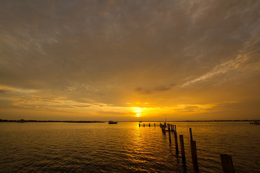 Sunset Photograph - Sunset At A Weathered Pier At Port Charlotte Harbor Near Punta  by Fizzy Image
