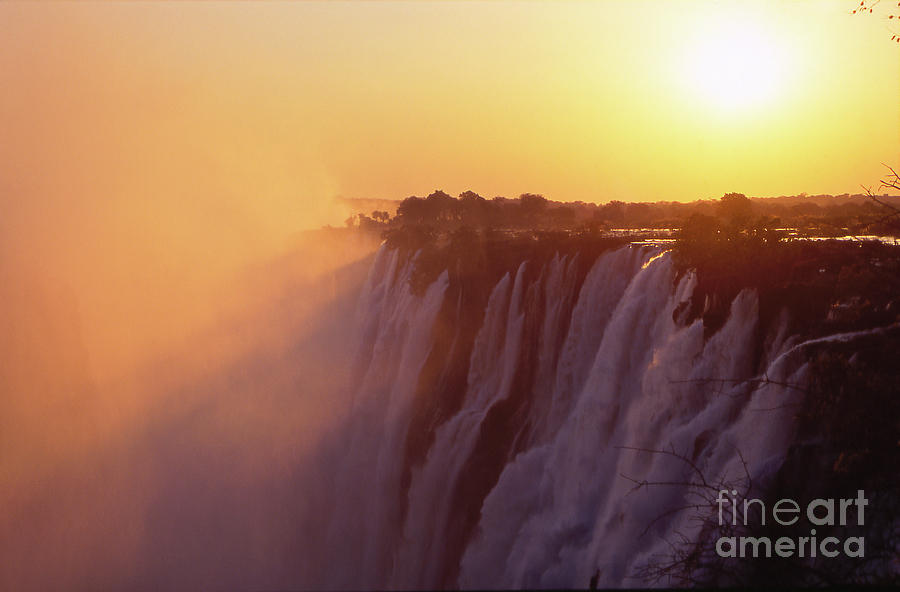 Sunset Over The Victoria Falls Photograph