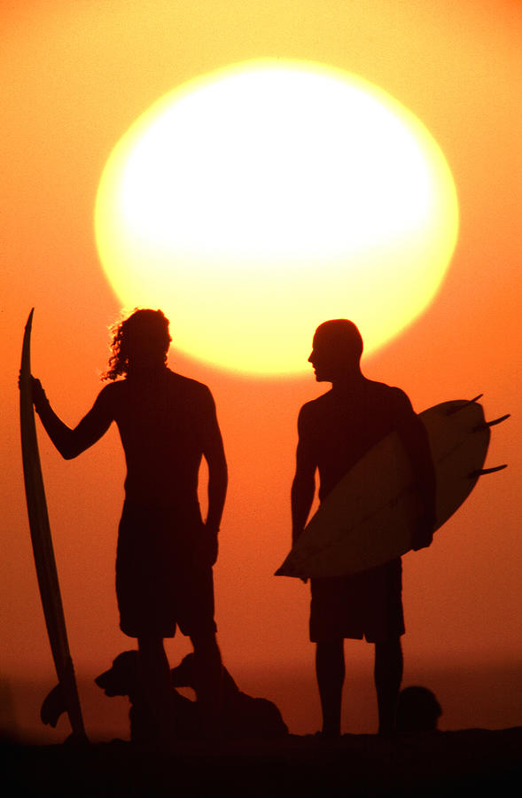 Sunset Surfers Photograph