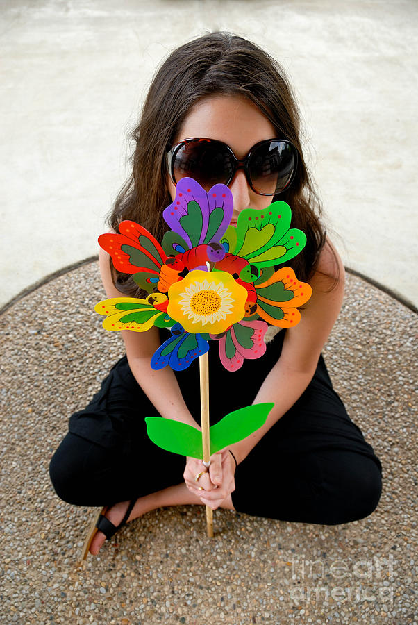 Teenage Girl Hiding Behind Toy Flower Photograph  - Teenage Girl Hiding Behind Toy Flower Fine Art Print