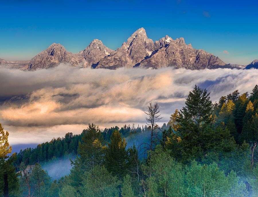 Tetons Above The Clouds Photograph