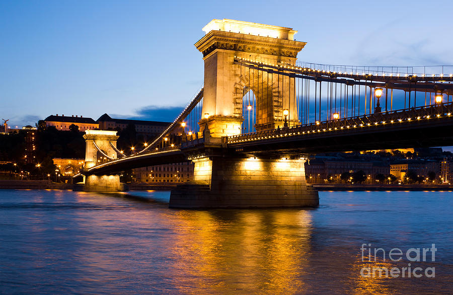 The Chain Bridge In Budapest Lit By The Street Lights Photograph