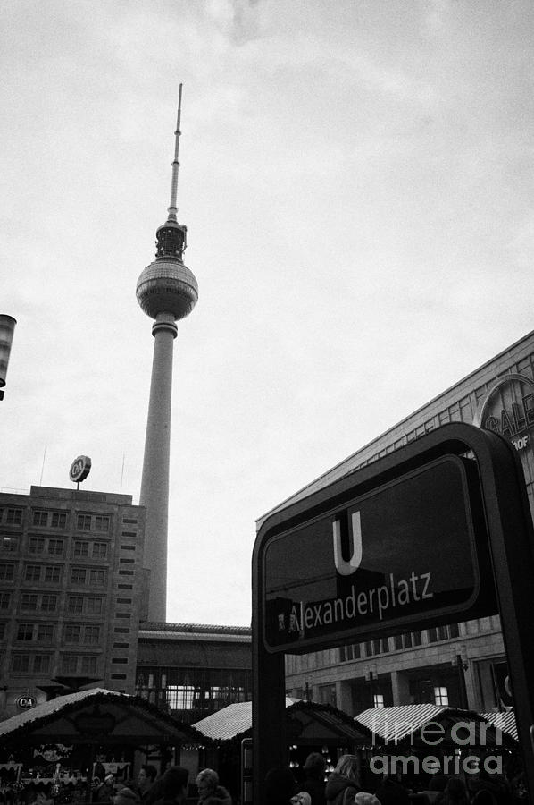 the christmas market in Alexanderplatz with the Berlin Fernsehturm and U-bahn sign Germany Photograph