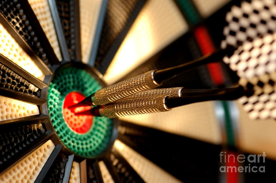 Three Arrows In The Centre Of A Dart Board Photograph