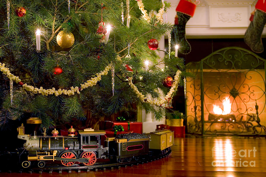 Toy Train Under The Christmas Tree Photograph  - Toy Train Under The Christmas Tree Fine Art Print