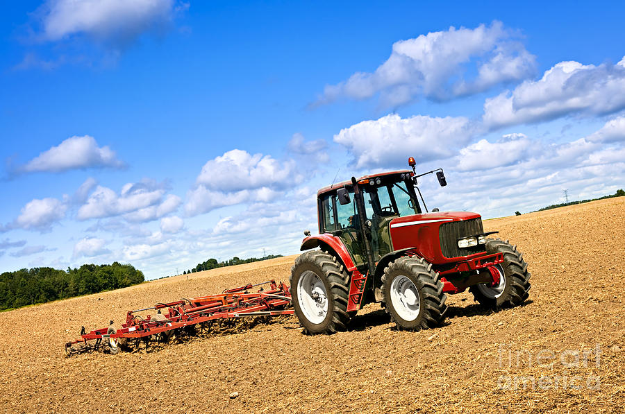 Tractor In Plowed Farm Field Photograph