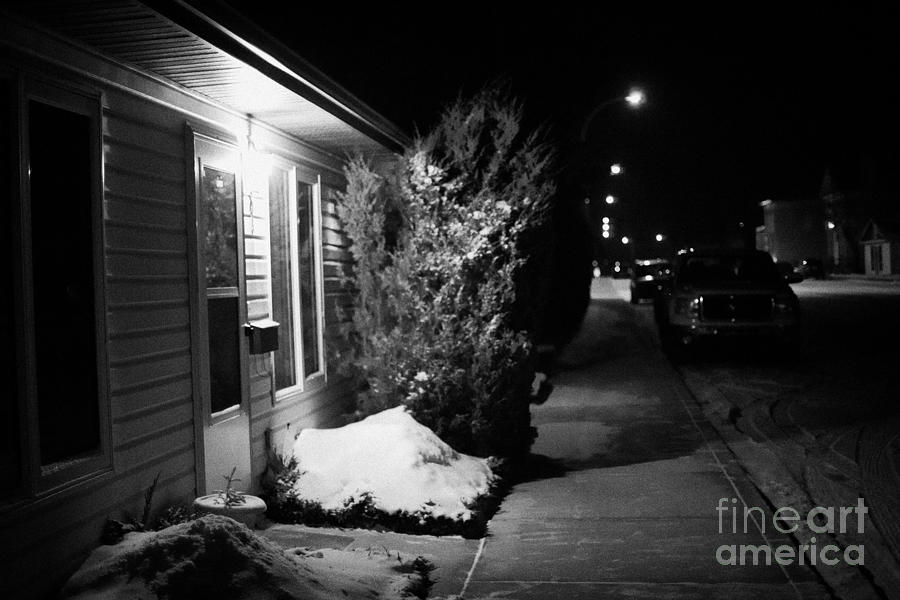 Traditional House With Porch Light Outside The Door And Snow Cleared Pavements At Night Delisle Sask Photograph  - Traditional House With Porch Light Outside The Door And Snow Cleared Pavements At Night Delisle Sask Fine Art Print
